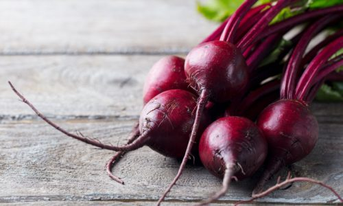 Fresh organic beet, beetroot on grey rustic wooden background. Copy space